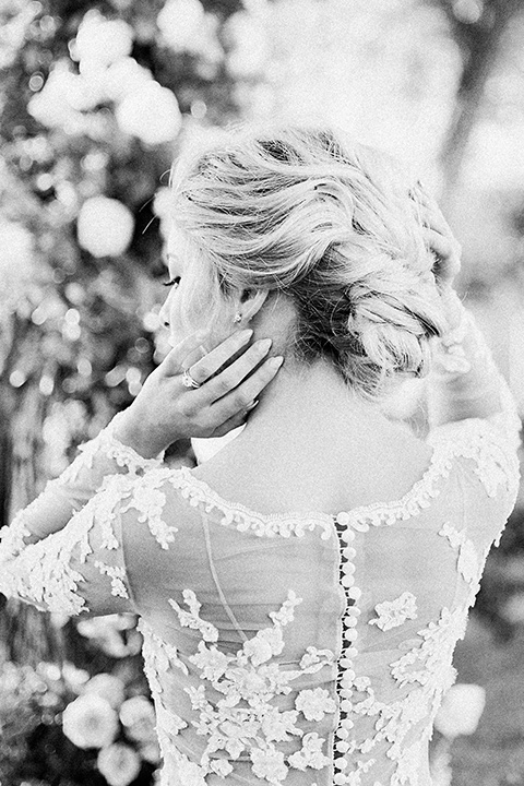 Inn-at-rancho-santa-fe-shoot-black-and-white-of-bride-hair-bride-in-a-lace-gown-with-an-illusion-detailing-with-a-nude-underlay-with-her-hair-in-back-in-a-loose-bun