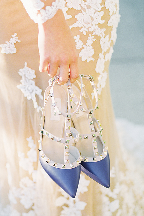 Inn-at-rancho-santa-fe-shoot-close-up-on-heels-blue-strappy-heels-with-studs-on-them