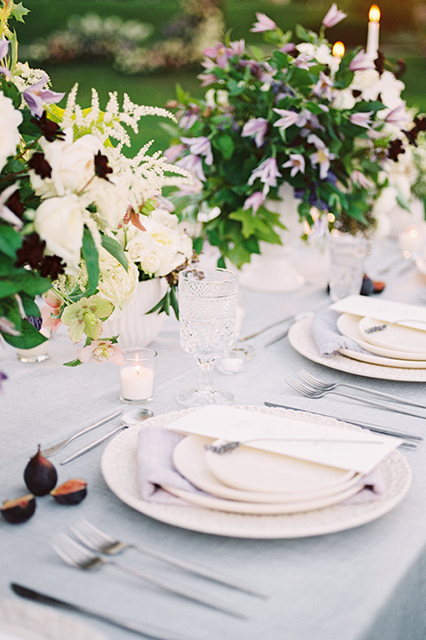 Inn-at-rancho-santa-fe-shoot-tavke-set-up-white-plates-on-silver-chargers-with-white-menue-cardds-and-twigs-of-lavander-and-metallic-silverware