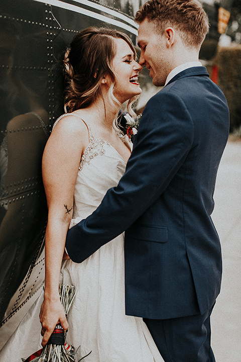 Orange-county-elegant-wedding-shoot-at-the-nixon-library-bride-and-groom-hugging-close-up
