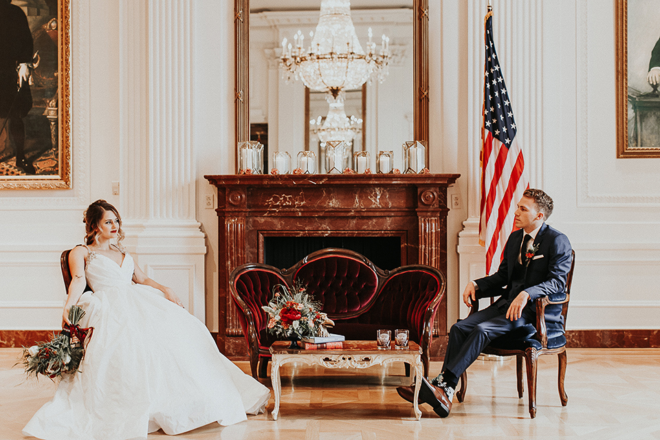 Orange-county-elegant-wedding-shoot-at-the-nixon-library-bride-and-groom-sitting-across-from-each-other