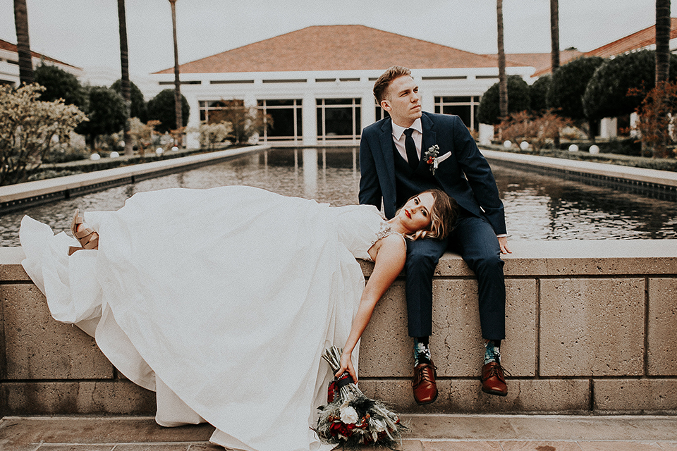 Orange-county-elegant-wedding-shoot-at-the-nixon-library-bride-and-groom-sitting-laying