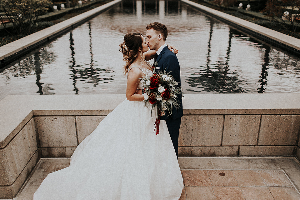 Orange-county-elegant-wedding-shoot-at-the-nixon-library-bride-and-groom-standing-and-kissing