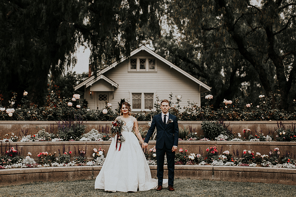 Orange-county-elegant-wedding-shoot-at-the-nixon-library-bride-and-groom-standing-holding-hands