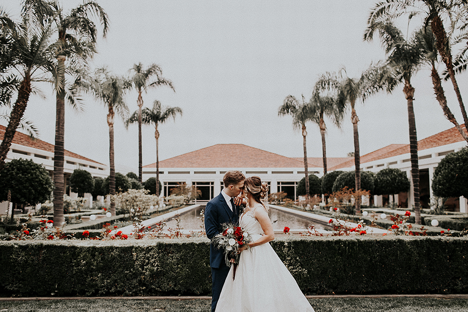 Orange-county-elegant-wedding-shoot-at-the-nixon-library-bride-and-groom-standing-kissing