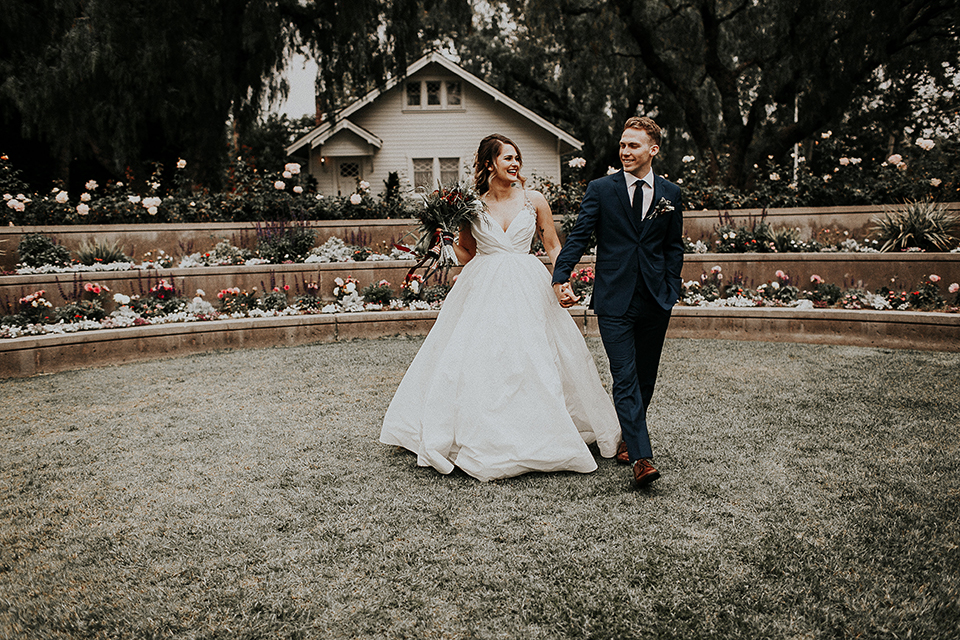 Orange-county-elegant-wedding-shoot-at-the-nixon-library-bride-and-groom-standing-walking
