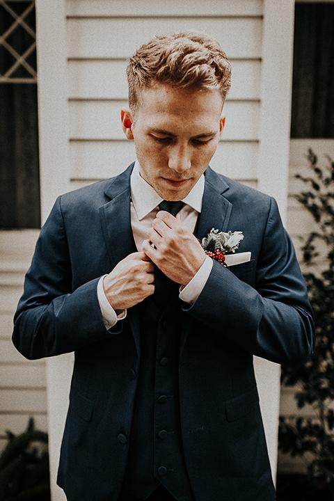 Orange-county-elegant-wedding-shoot-at-the-nixon-library-groom-fixing-tie