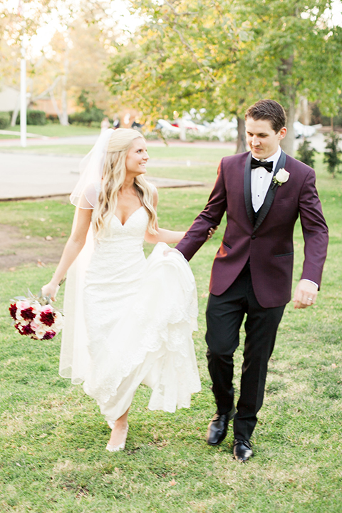 Autumn-inspired-wedding-at-coto-valley-country-club-bride-and-groom-holding-hands-walking