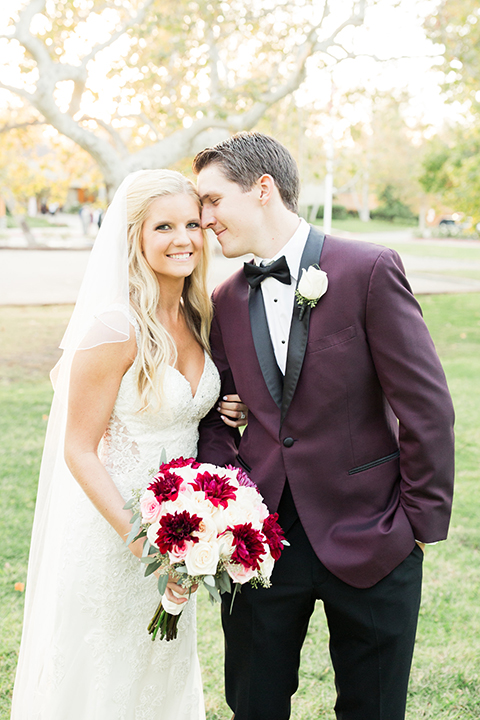 Autumn-inspired-wedding-at-coto-valley-country-club-bride-and-groom-hugging-smiling