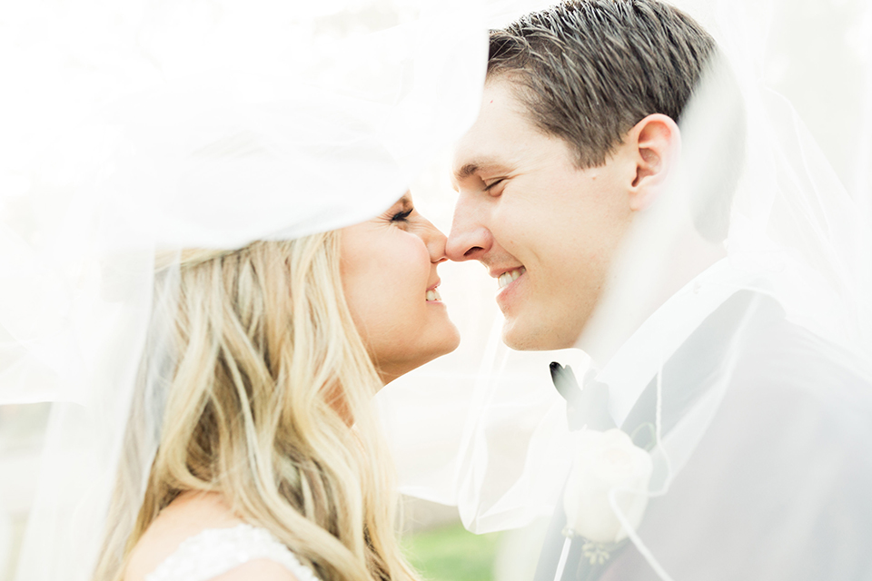 Autumn-inspired-wedding-at-coto-valley-country-club-bride-and-groom-kissing-under-veil