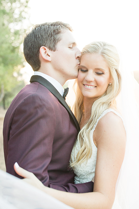 Autumn-inspired-wedding-at-coto-valley-country-club-bride-and-groom-standing-hugging-close-up
