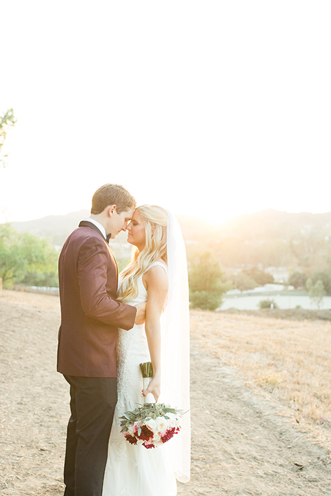 Autumn-inspired-wedding-at-coto-valley-country-club-bride-and-groom-standing-hugging
