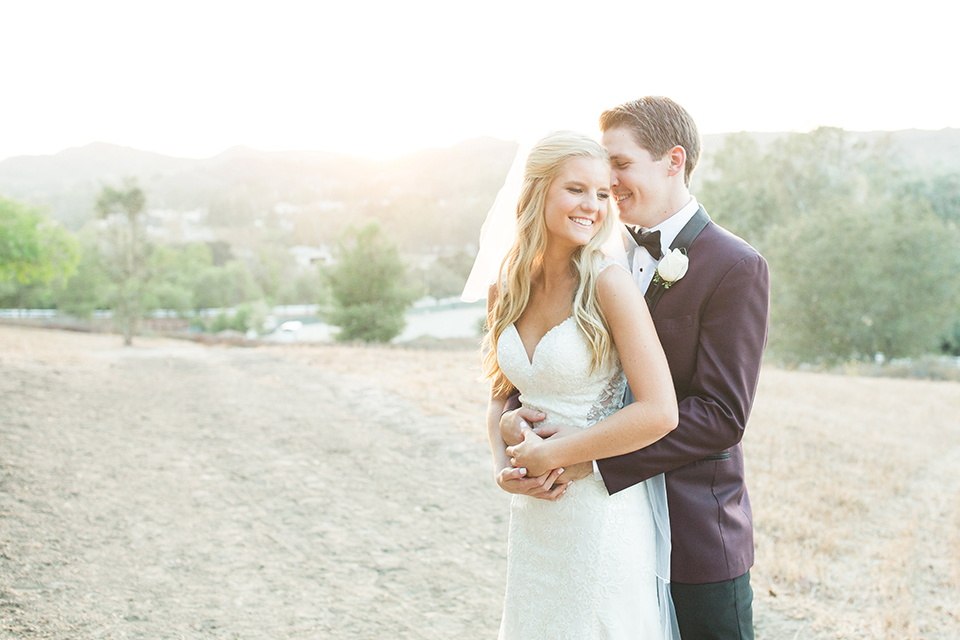 Autumn-inspired-wedding-at-coto-valley-country-club-bride-and-groom-standing-smiling