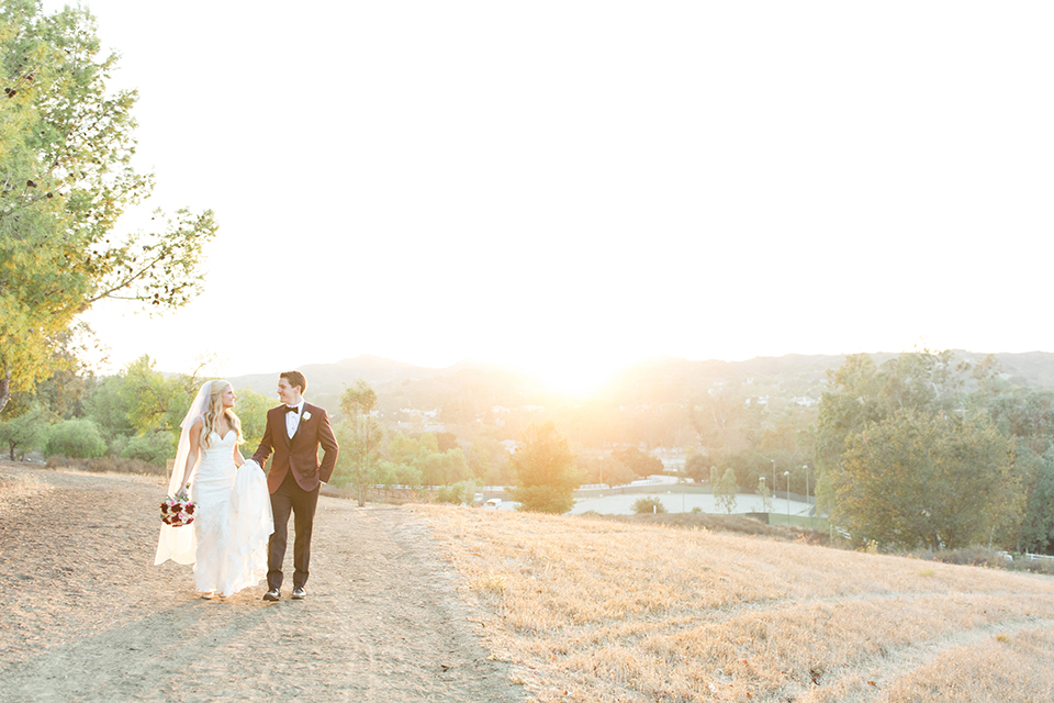 Autumn-inspired-wedding-at-coto-valley-country-club-bride-and-groom-standing-walking
