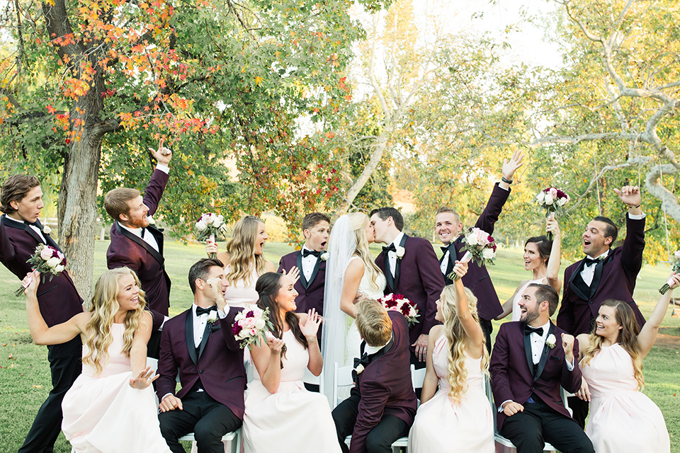 Autumn-inspired-wedding-at-coto-valley-country-club-bride-and-groom-with-wedding-party-cheering