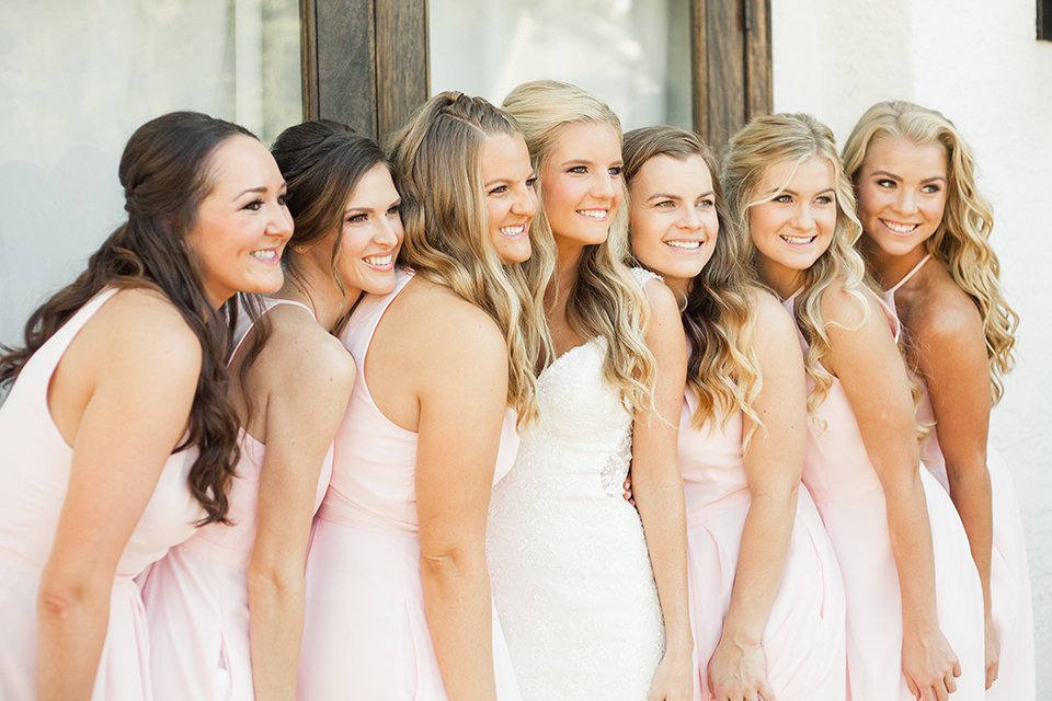 Autumn-inspired-wedding-at-coto-valley-country-club-bride-with-bridesmaids-smiling