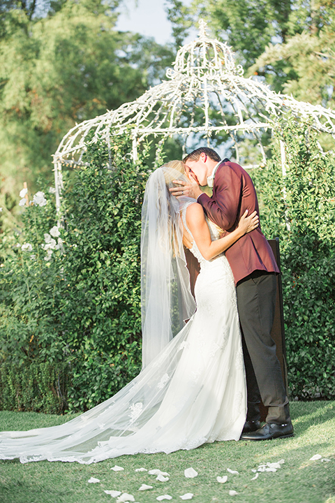 Autumn-inspired-wedding-at-coto-valley-country-club-ceremony-bride-and-groom-kissing