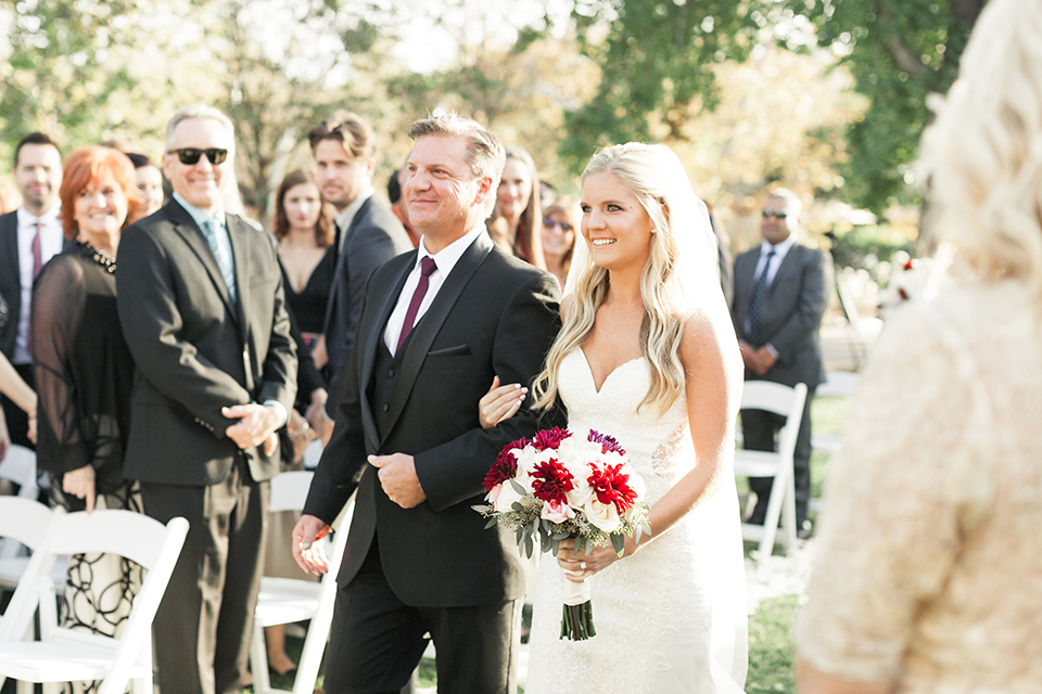 Autumn-inspired-wedding-at-coto-valley-country-club-ceremony-bride-walking-down-the-aisle