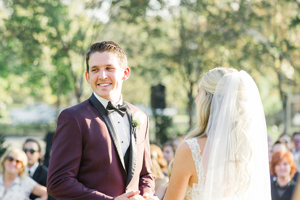 Autumn-inspired-wedding-at-coto-valley-country-club-ceremony-groom-smiling