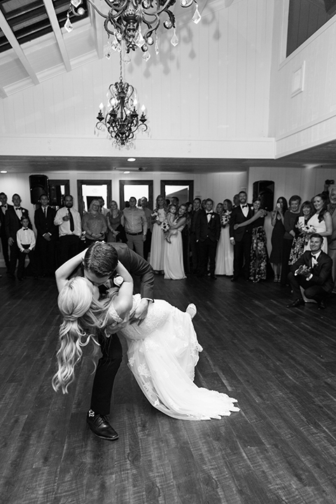 Autumn-inspired-wedding-at-coto-valley-country-club-reception-bride-and-groom-first-dance-kissing