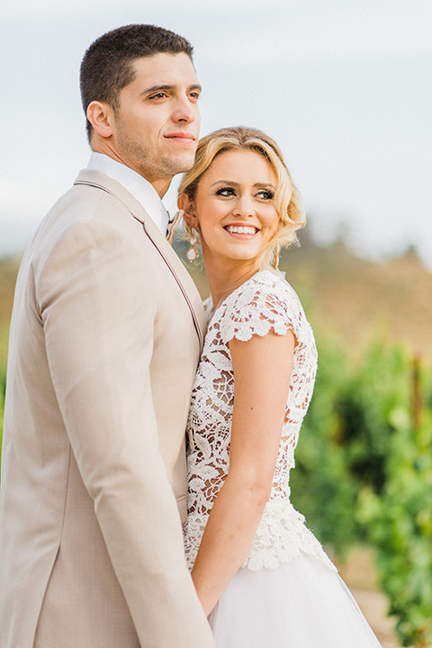 Temecula-outdoor-wedding-at-avensole-winery-bride-and-groom-holding-hands-close-up