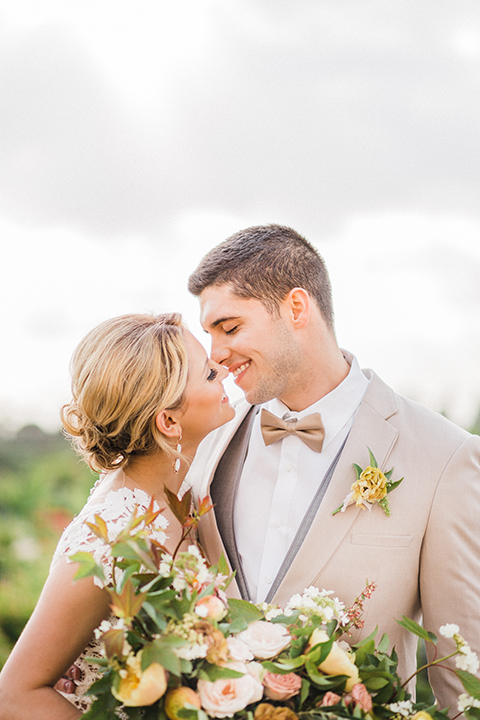 Temecula-outdoor-wedding-at-avensole-winery-bride-and-groom-kissing-and-smiling