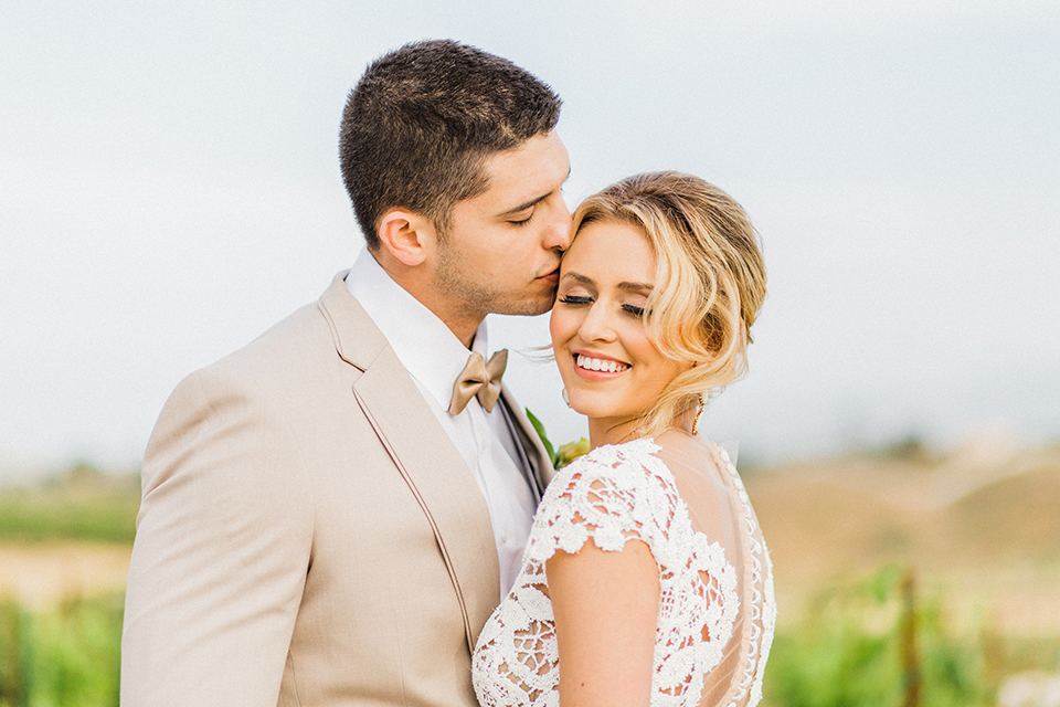 Temecula-outdoor-wedding-at-avensole-winery-bride-and-groom-kissing-close-up