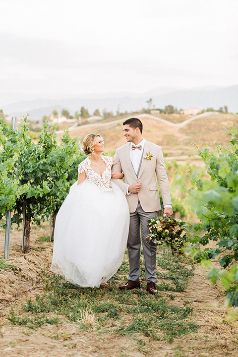 Temecula-outdoor-wedding-at-avensole-winery-bride-and-groom-standing-holding-hands