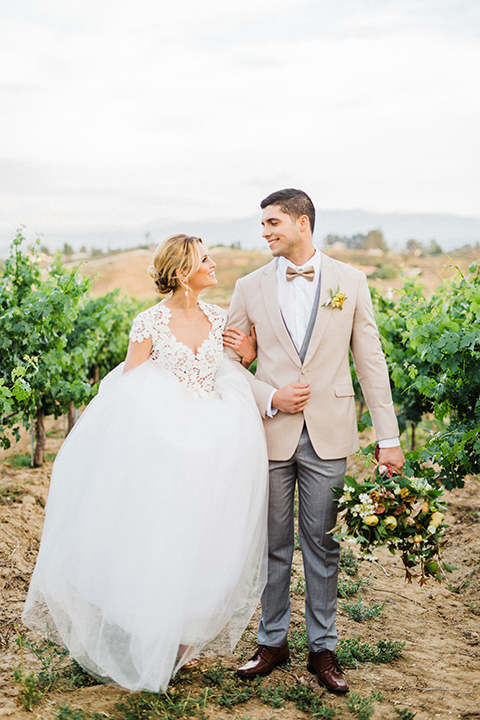 Temecula-outdoor-wedding-at-avensole-winery-bride-and-groom-standing-walking
