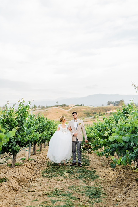Temecula-outdoor-wedding-at-avensole-winery-bride-and-groom-walking