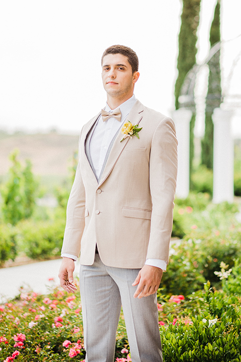 Temecula-outdoor-wedding-at-avensole-winery-groom-tan-suit-with-grey-pants