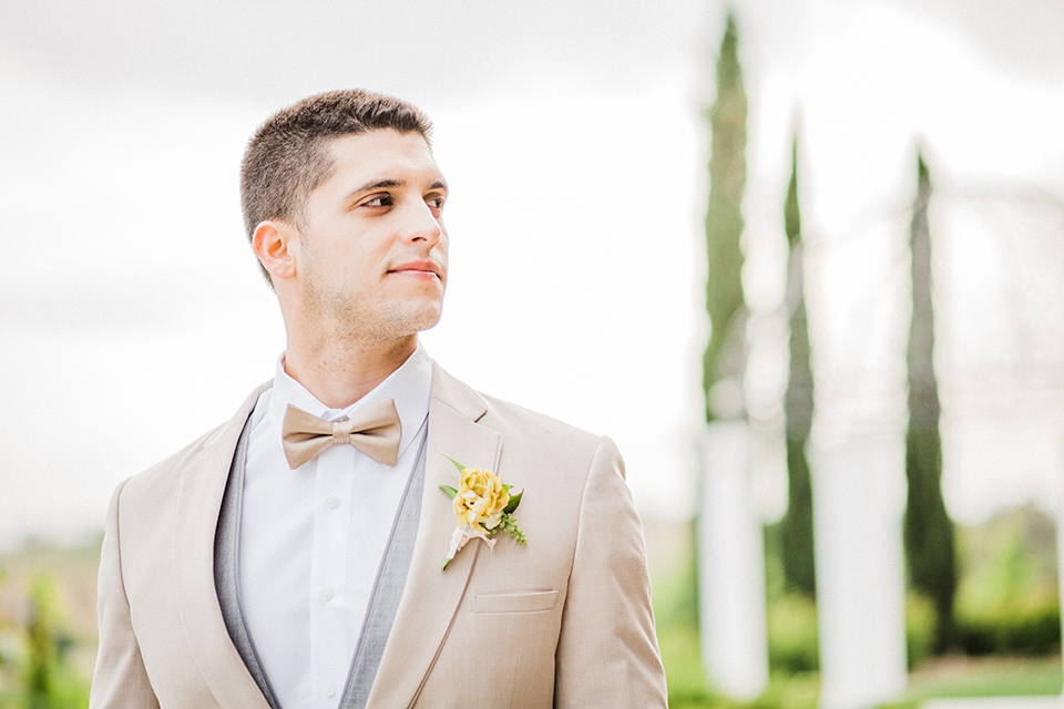 Temecula-outdoor-wedding-at-avensole-winery-groom-tan-suit