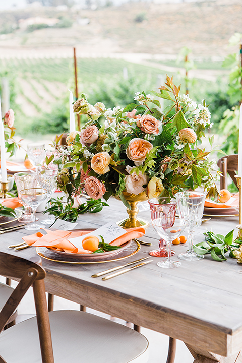Temecula-outdoor-wedding-at-avensole-winery-table-set-up-with-flowers-and-candles