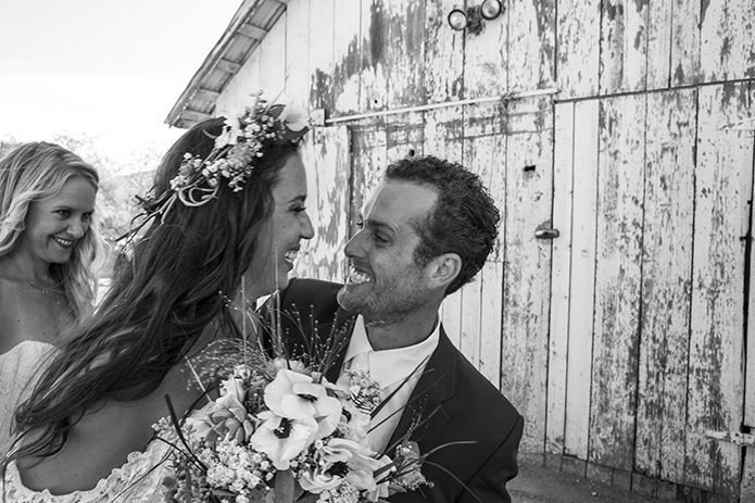 Rustic-barn-outdoor-wedding-bride-and-groom-smiling-black-and-white