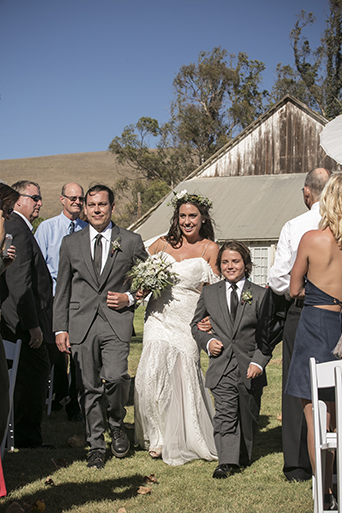 Rustic-barn-outdoor-wedding-bride-lace-gown-walking-down-the-aisle-with-dad