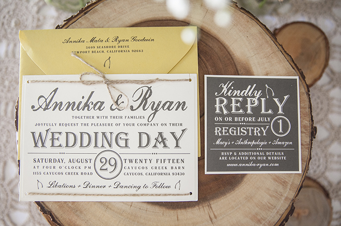 Rustic-barn-outdoor-wedding-white-and-black-wedding-invitations-on-wood-background