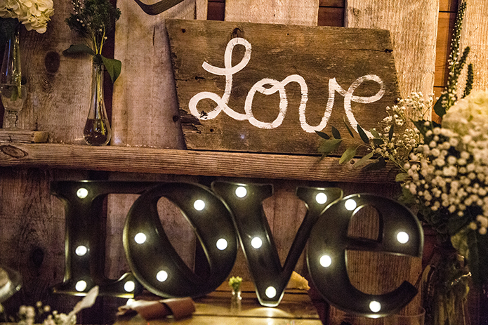 Rustic-barn-outdoor-wedding-wood-love-sign-with-marquee-love-letters