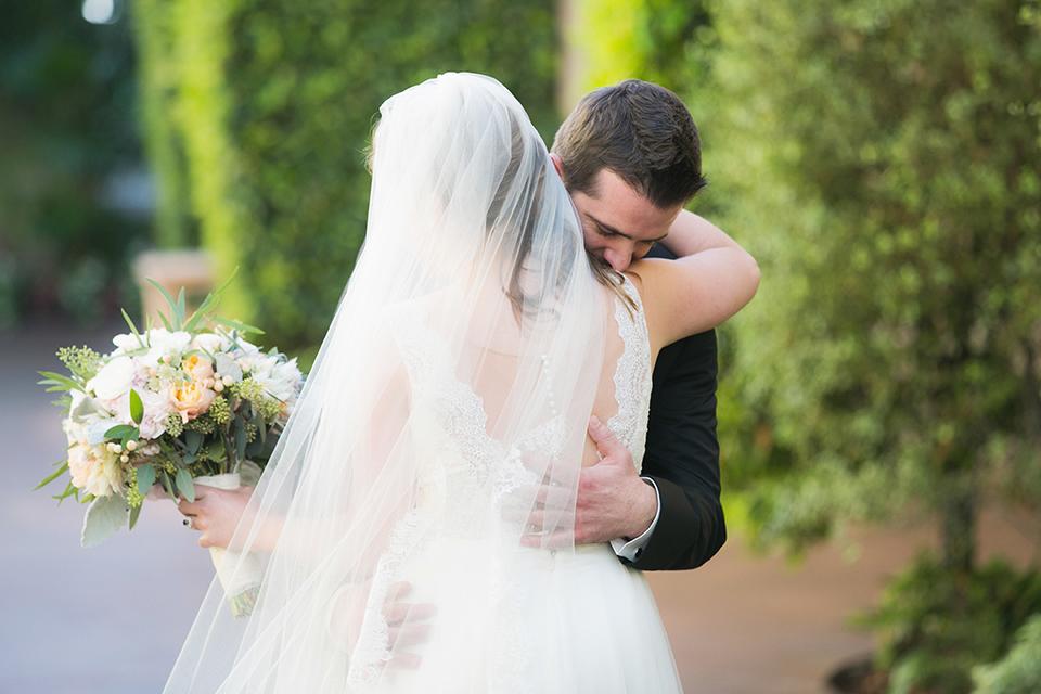 Balboa-bay-resort-wedding-bride-and-groom-first-look-hugging