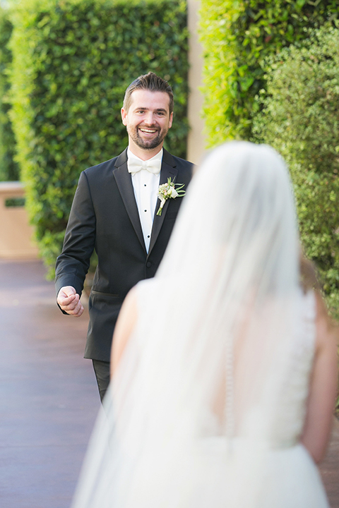 Balboa-bay-resort-wedding-bride-and-groom-first-look-smiling