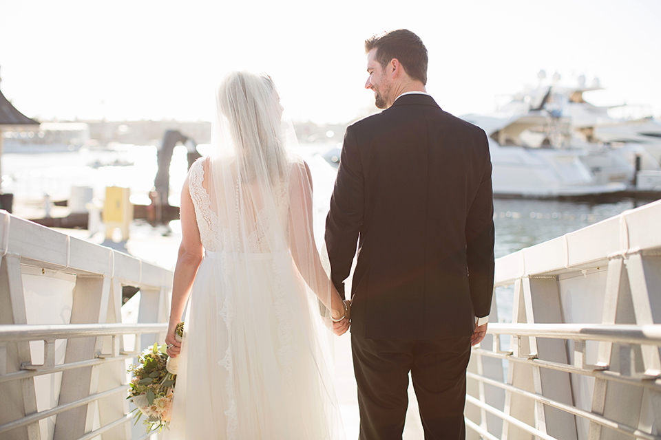Balboa-bay-resort-wedding-bride-and-groom-holding-hands-and-bouquet