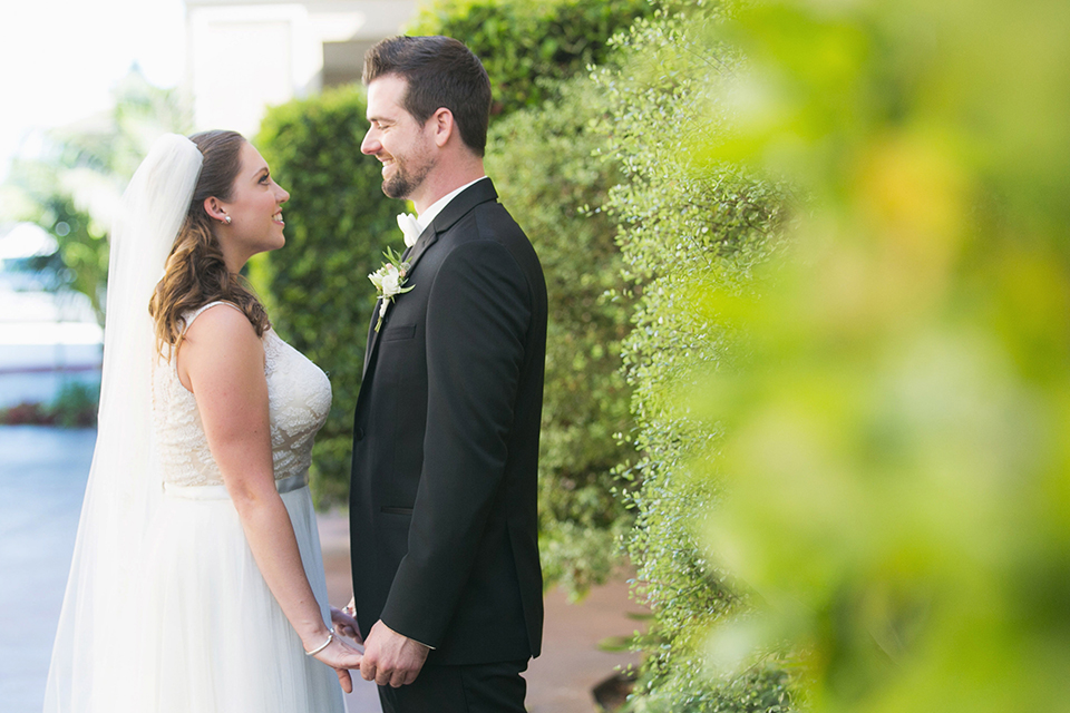 Balboa-bay-resort-wedding-bride-and-groom-holding-hands