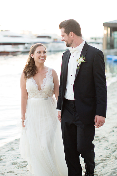 Balboa-bay-resort-wedding-bride-and-groom-on-beach-smiling