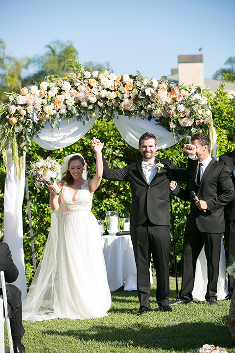 Balboa-bay-resort-wedding-ceremony-bride-and-groom-cheering
