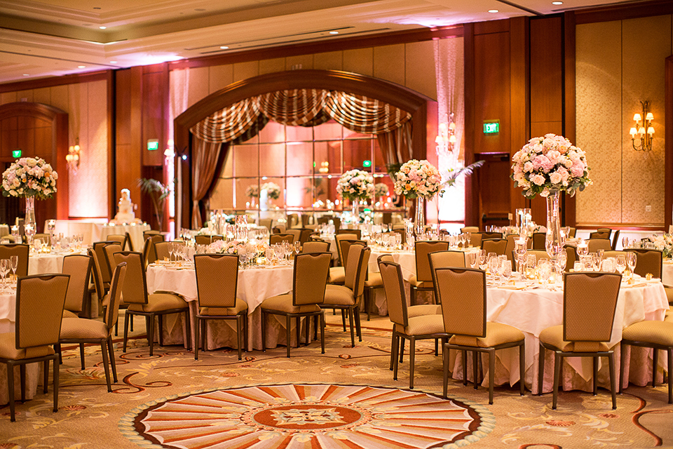 Balboa-bay-resort-wedding-reception-set-up-with-white-table-linens-and-flower-decor
