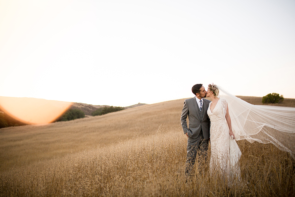 Bohemian-outdoor-wedding-shoot-bride-and-groom-standing-kissing