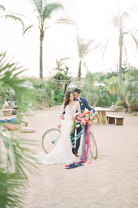 Caravan-outpost-outdoor-wedding-shoot-bride-and-groom-by-bike-far-away