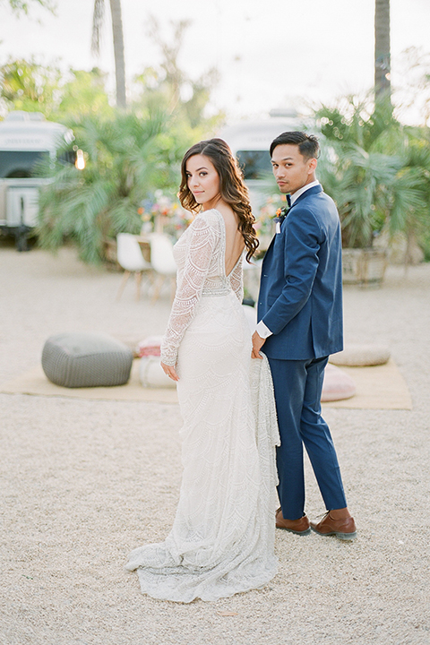 Caravan-outpost-outdoor-wedding-shoot-bride-and-groom-holding-hands-walking