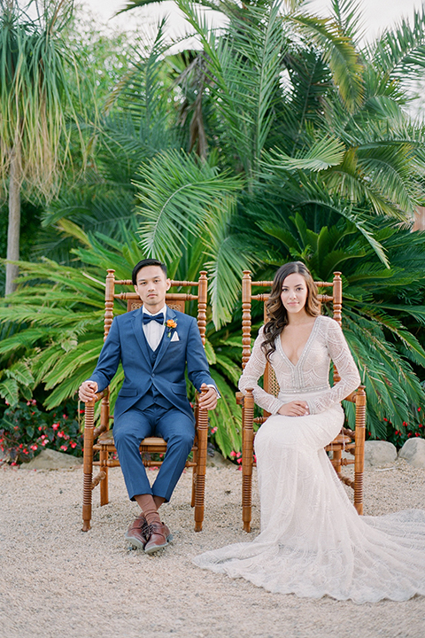 Caravan-outpost-outdoor-wedding-shoot-bride-and-groom-sitting-in-chairs