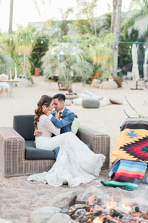 Caravan-outpost-outdoor-wedding-shoot-bride-and-groom-sitting-on-couch