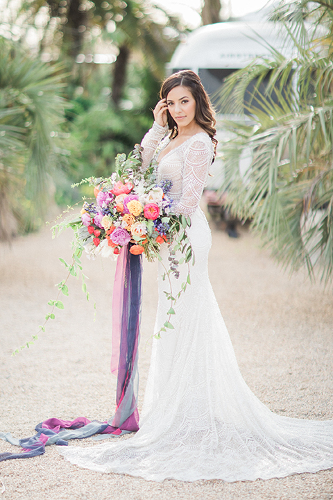 Caravan-outpost-outdoor-wedding-shoot-bride-holding-bouquet